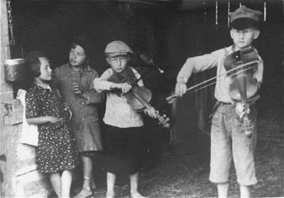 Jewish children in the Krakow ghetto play violins for the cameraman 1939 - 1940.